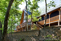 Exterior, horizontal, lake elevation with retaining wall, Marshall residence, Grand Vista Bay, Rockwood, Tennessee, Honest Abe Log Homes