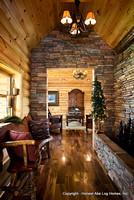 Interior, vertical, looking through hallway with water feature into den, Wilson residence, Crossville, Tennessee; Honest Abe Log Homes