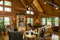 Interior, horizontal, living room looking out windows, Alderson residence, Clinton, Arkansas, Honest Abe Log Homes