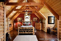 Interior, horizontal, guest bedroom with dormer, Wilson residence, Crossville, Tennessee; Honest Abe Log Homes