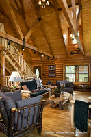 Interior, vertical, living room toward entry, loft and stairway, Alderson residence, Clinton, Arkansas, Honest Abe Log Homes