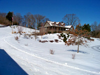 (72) 6x12 Genesis Log Home in the Snow