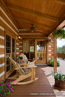 Exterior, vertical, rear porch with rocking chairs, DeSocio residence, Henry, Tennessee, Honest Abe Log Homes