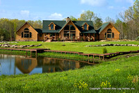 Exterior, horizontal, front elevation overall with pond in foreground, Wilson residence, Crossville, Tennessee; Honest Abe Log Homes